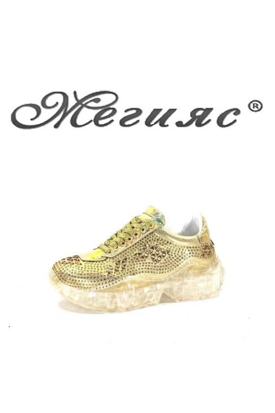 95  Lady sport shoes gold PU